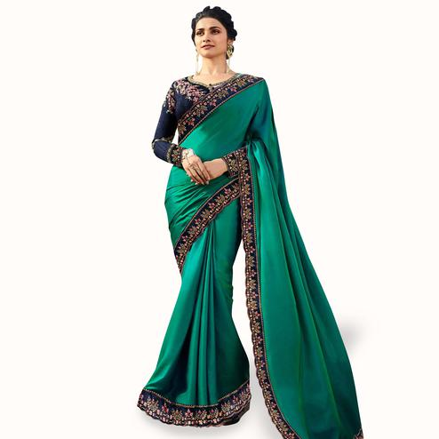 Elegant Turquoise Green Colored Partywear Embroidered Art Silk Saree