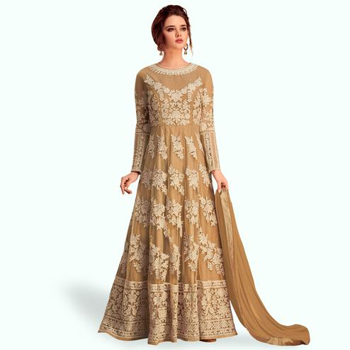 Alluring Beige Colored Partywear Embroidered Silk & Net Anarkali Suit