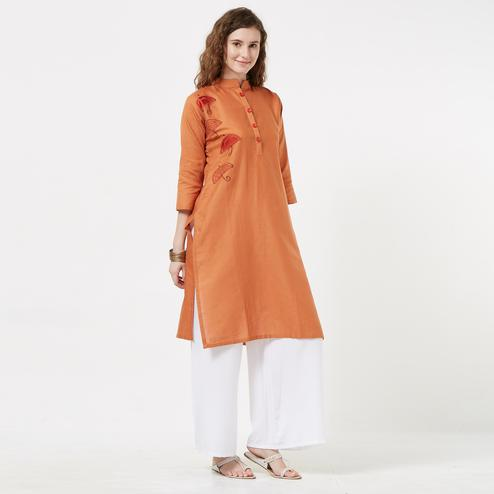 Captivating Rust Orange Colored Casual Embroidered Cotton Kurti