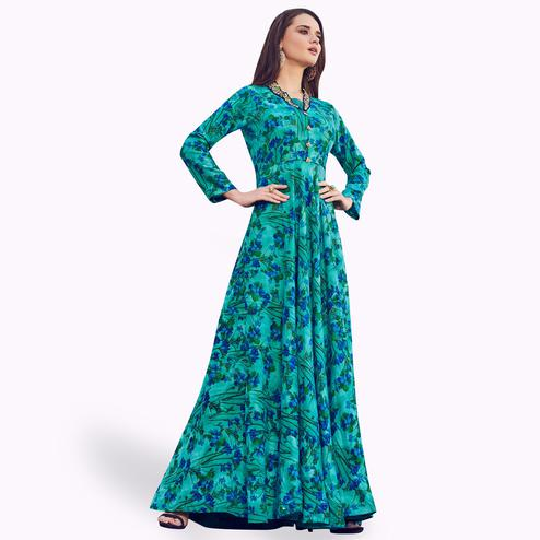 Magnetic Aqua Blue Colored Partywear Printed Rayon Gown