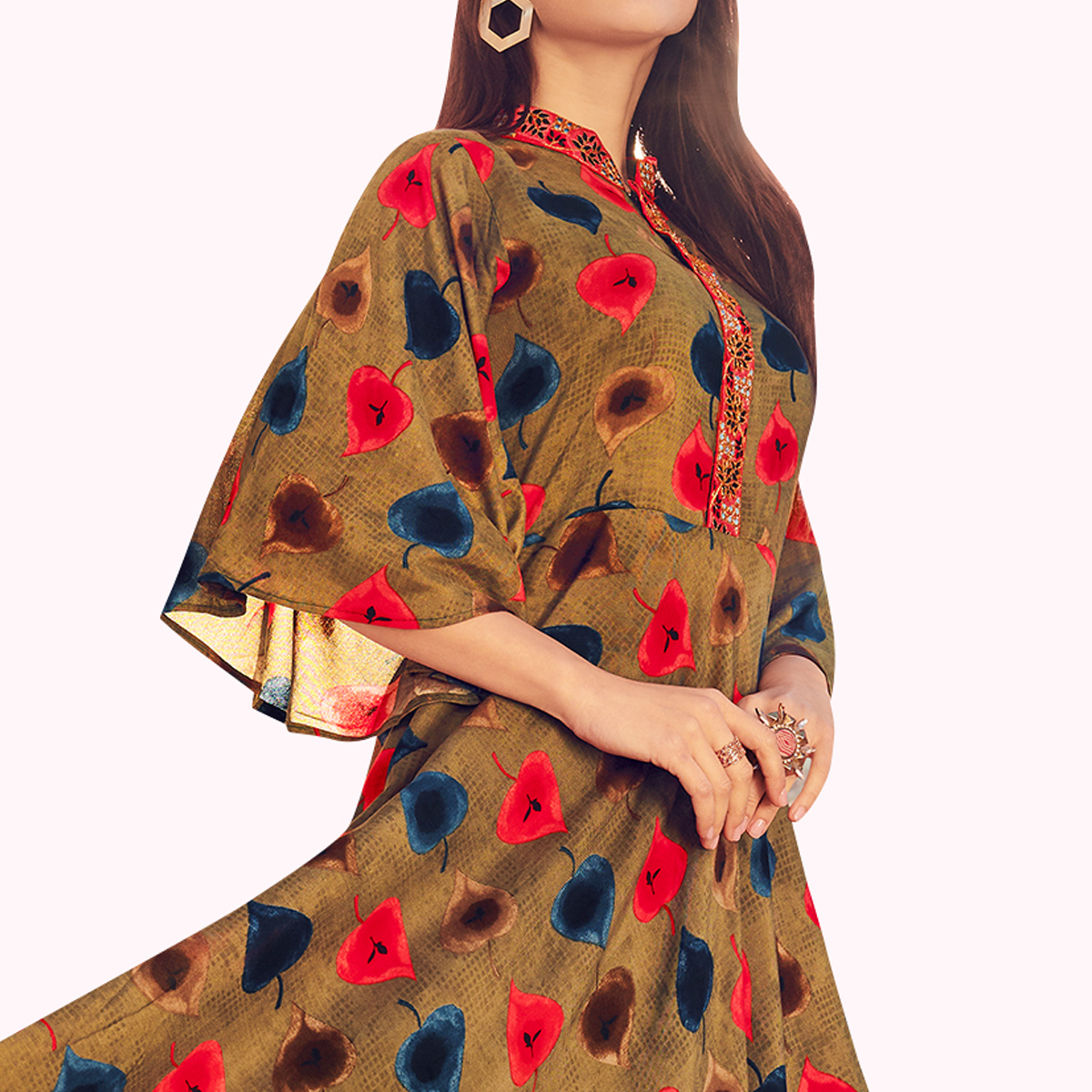 Excellent Chiku Colored Partywear Printed Rayon Gown