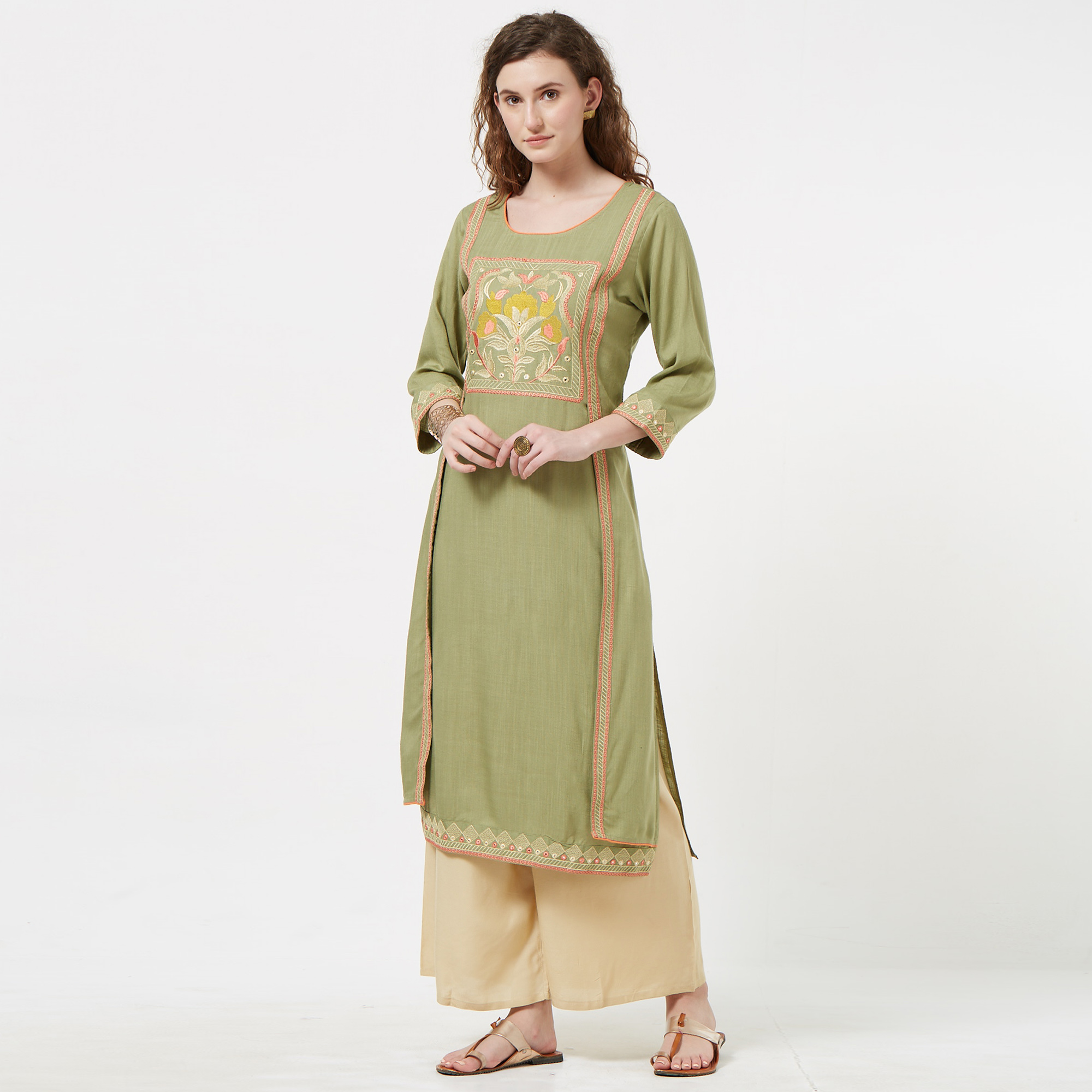 Fantastic Pastel Green Colored Partywear Embroidered Rayon Long Kurti