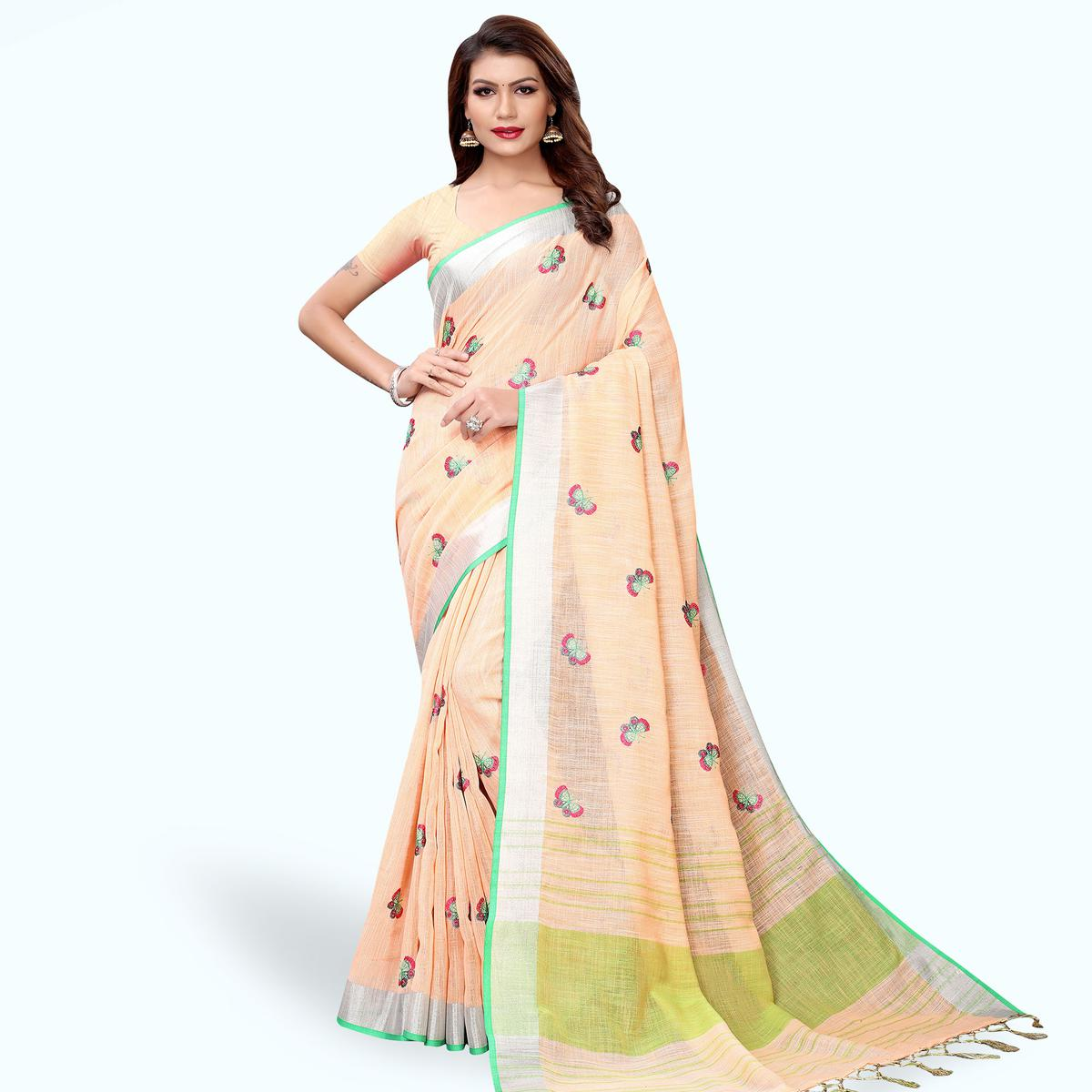 Exceptional Pastel Peach Colored Partywear Embroidered Linen Saree