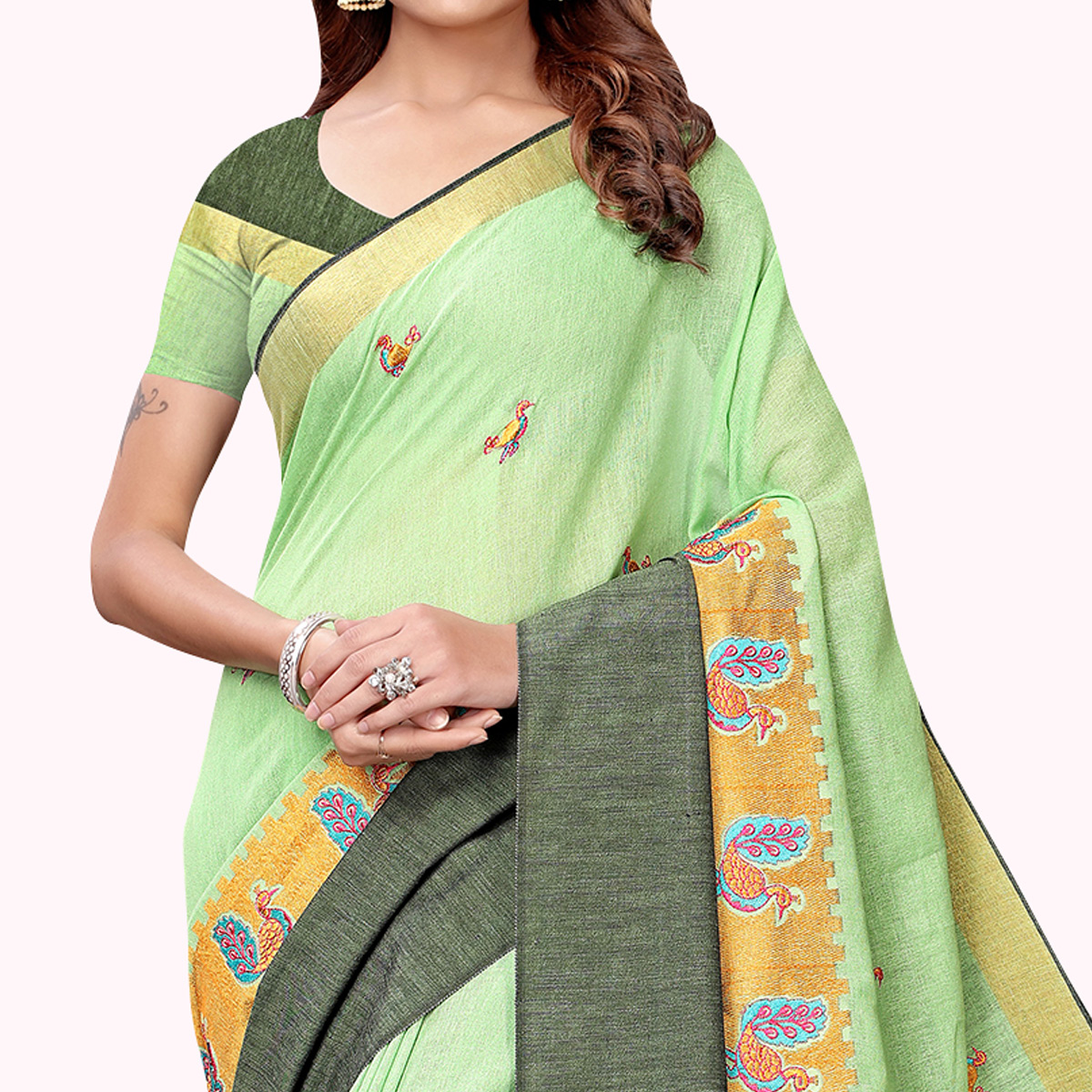 Mesmeric Pastel Green Colored Partywear Embroidered Linen Saree