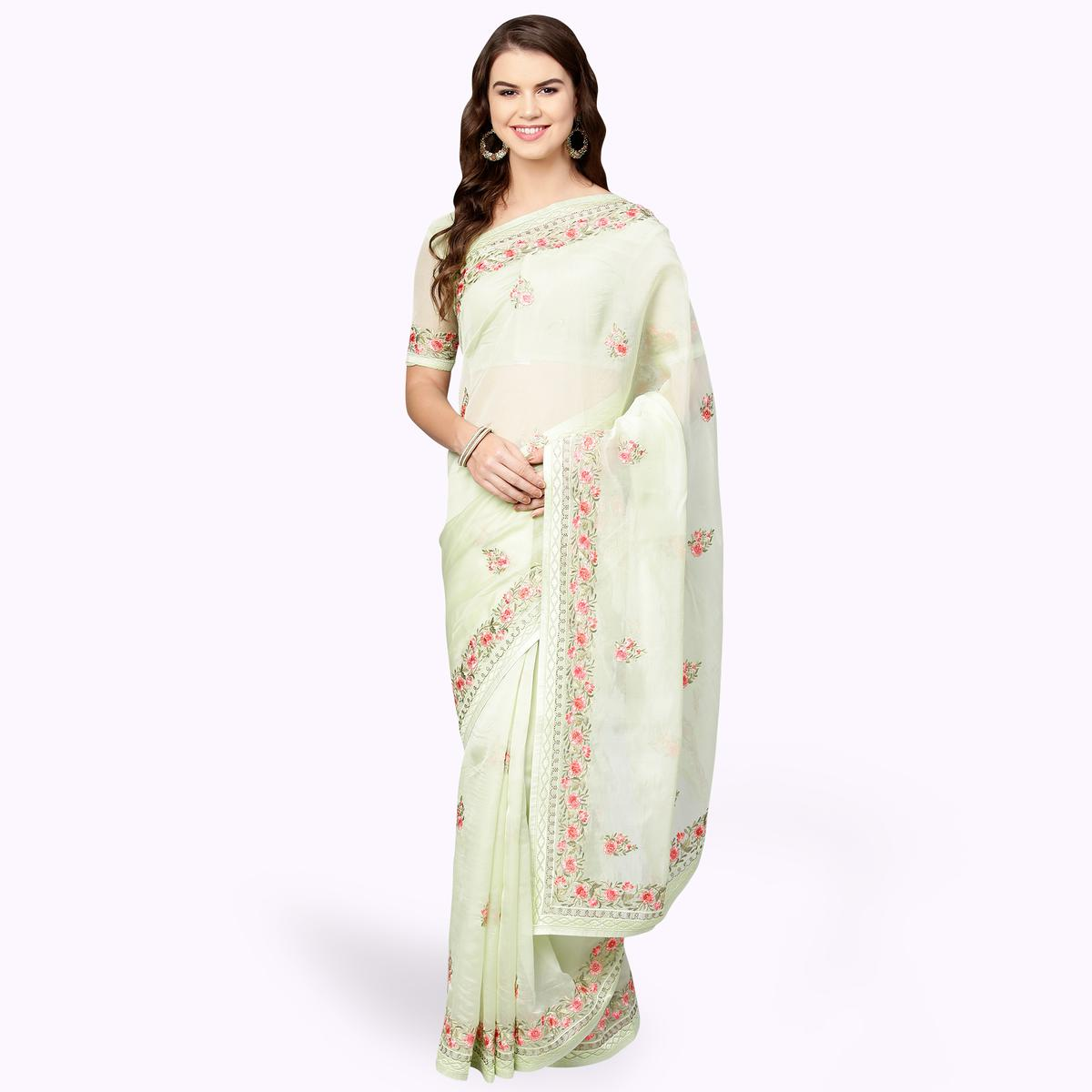 Adorable Pastel Green Colored Partywear Embroidered Organza Saree