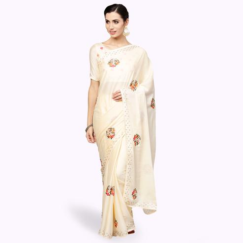 Charming Cream Colored Partywear Embroidered Organza Saree
