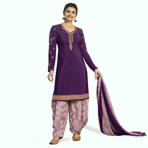 Opulent Purple Colored Partywear Embroidered Crepe Patiala Suit