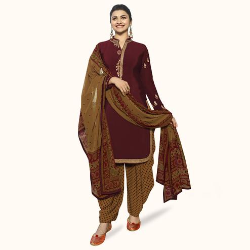 Glowing Maroon Colored Partywear Embroidered Crepe Patiala Suit