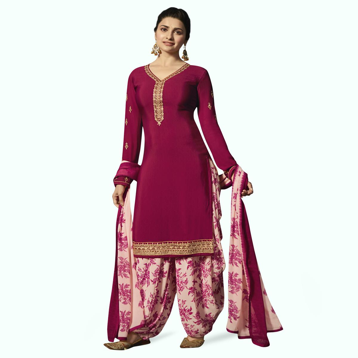 Gleaming Dark Magenta Pink Colored Partywear Embroidered Crepe Patiala Suit