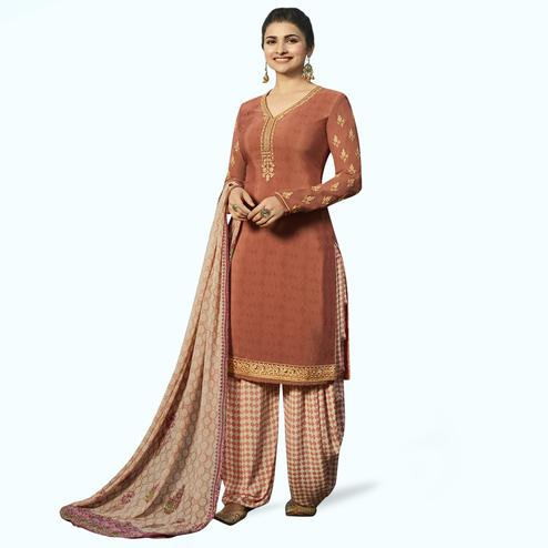 Unique Rust Orange Colored Partywear Embroidered Crepe Patiala Suit