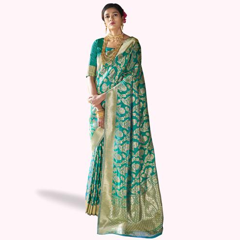 Mesmeric Turquoise Green Colored Festive Wear Woven Silk Saree