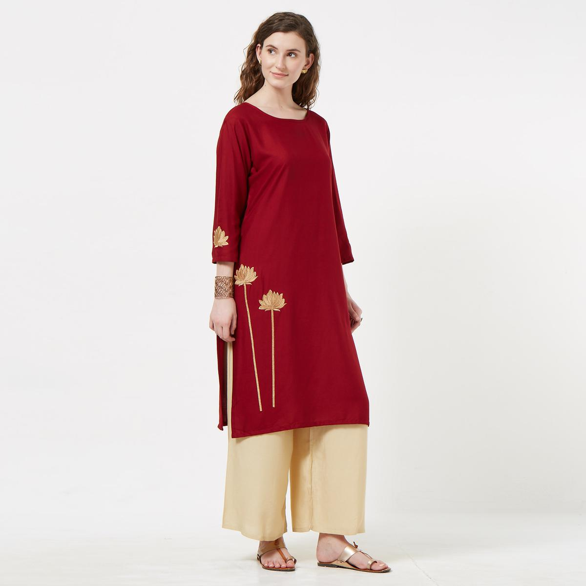 Impressive Maroon Colored Partywear Embroidered Rayon Kurti