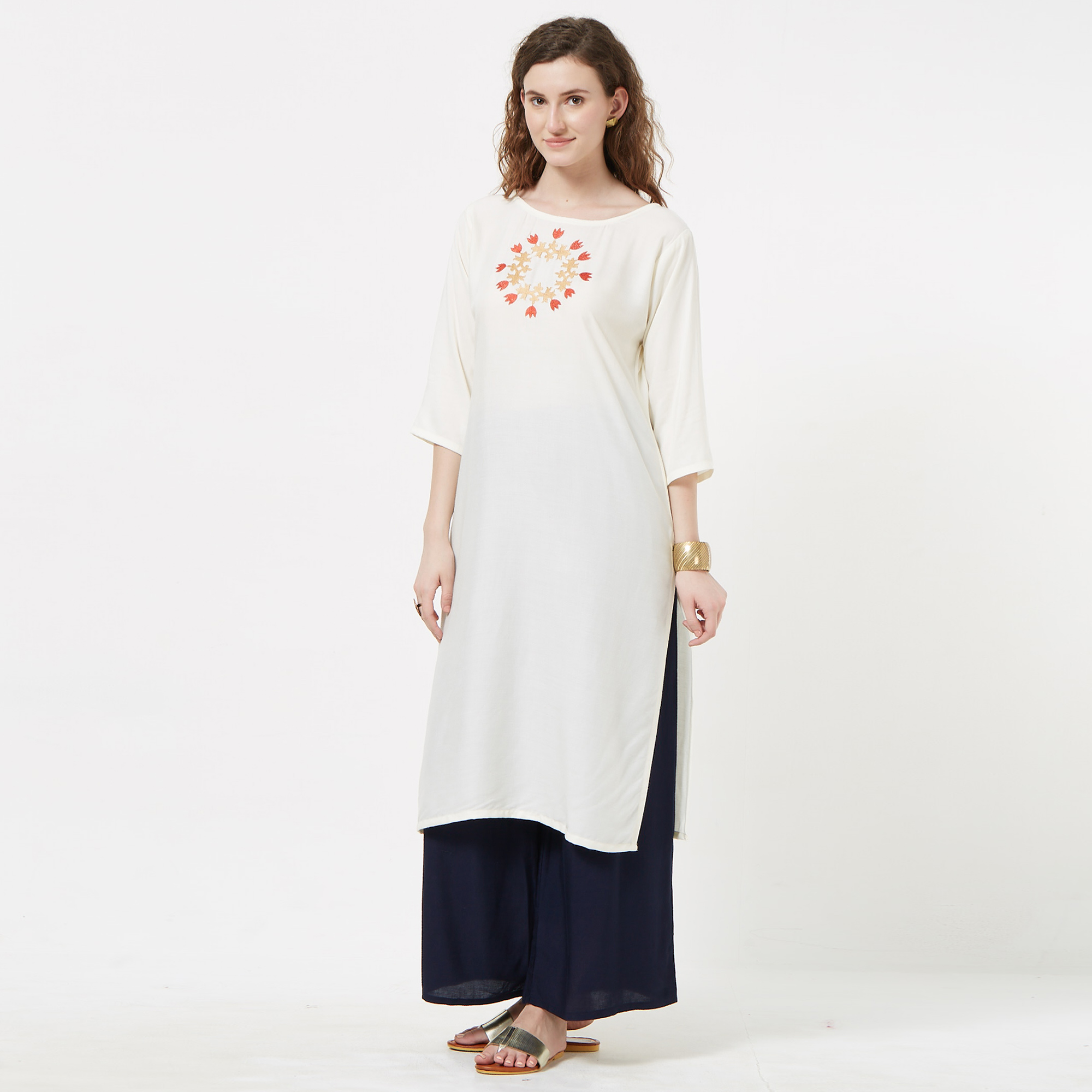 Mesmeric Cream Colored Partywear Embroidered Rayon Kurti