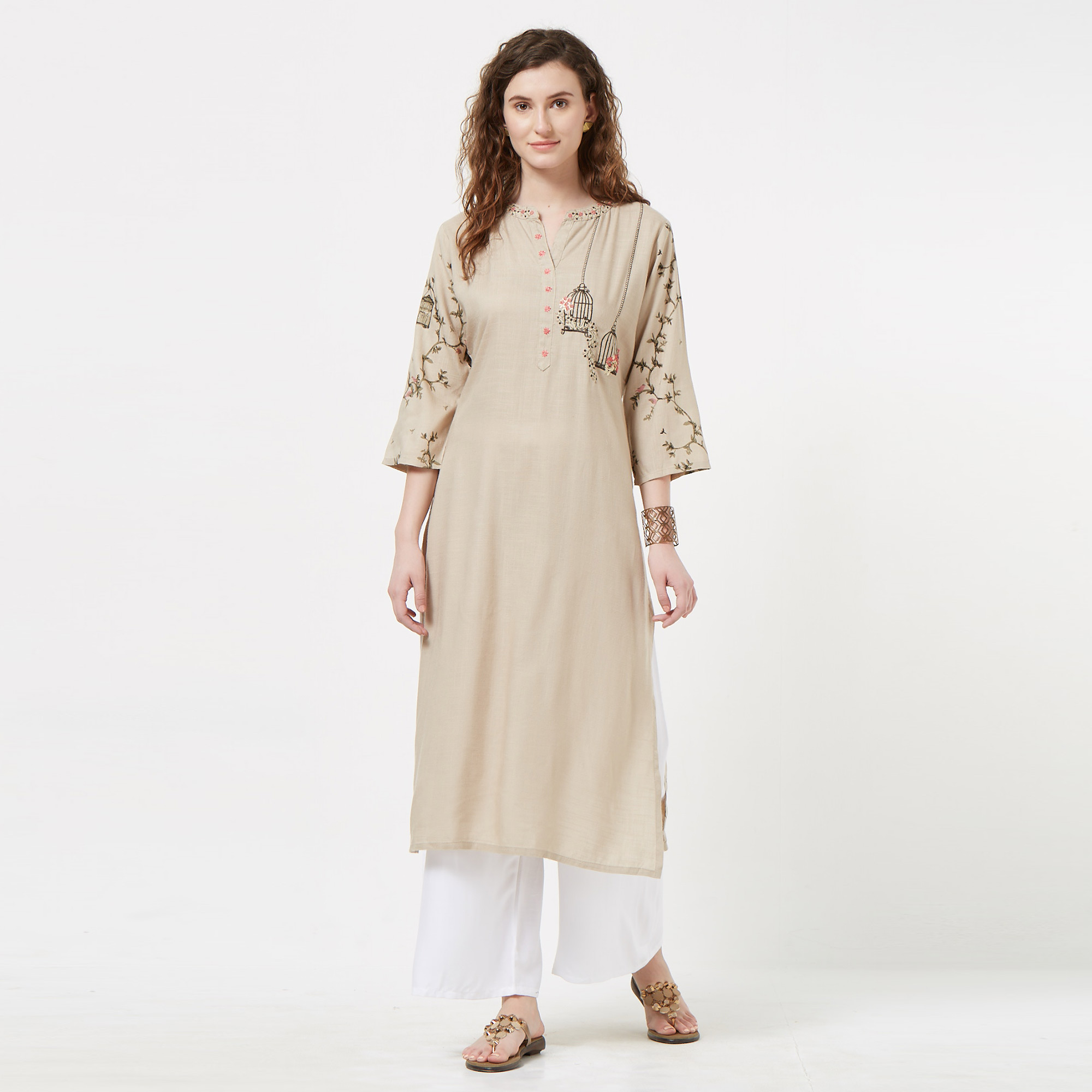 Staring Beige Colored Partywear Embroidered Cotton Kurti