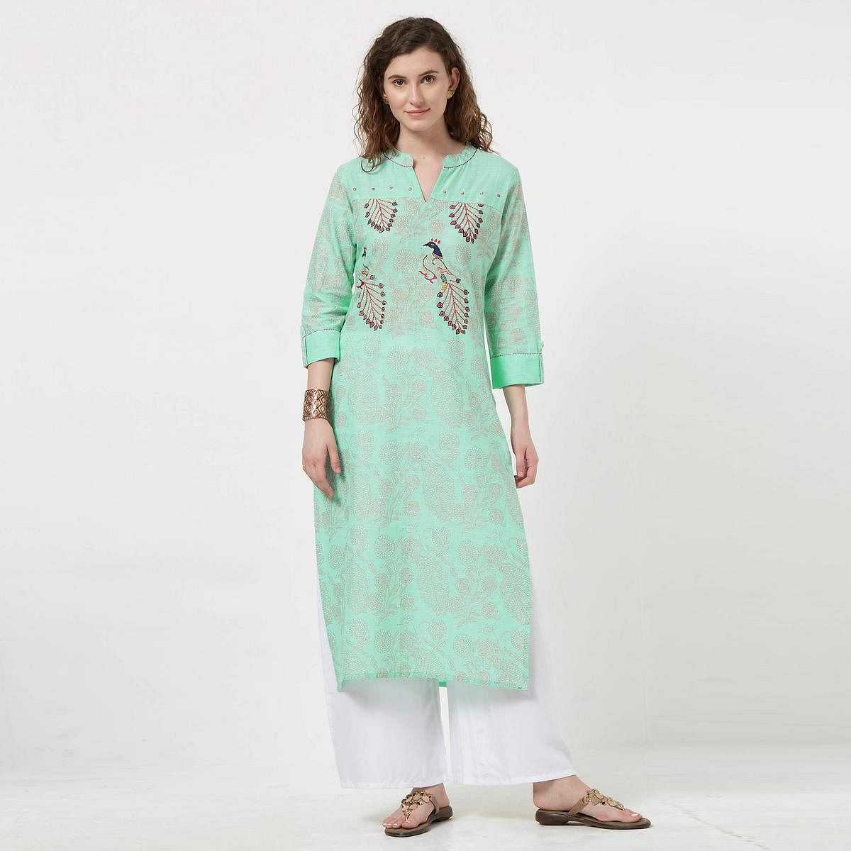 Dazzling Mint Green Colored Partywear Embroidered Cotton Kurti