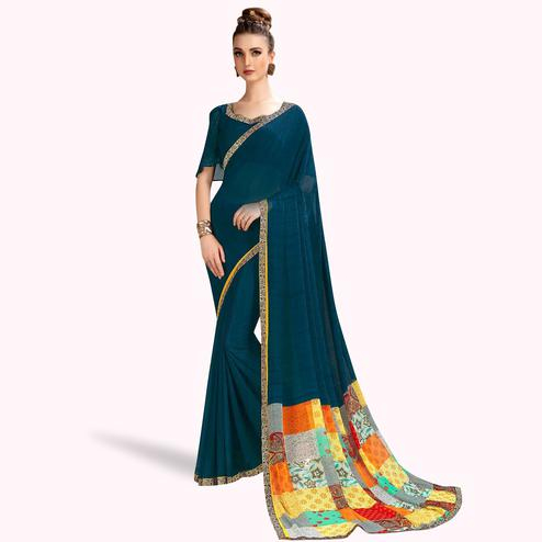 Exceptional Teal Blue Colored Casual Printed Georgette Saree