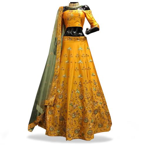 Amazing Yellow Colored Partywear Embroidered Tapeta Silk Lehenga Choli