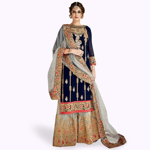 Marvellous Navy Blue Colored Partywear Embroidered Faux Georgette Palazzo Suit