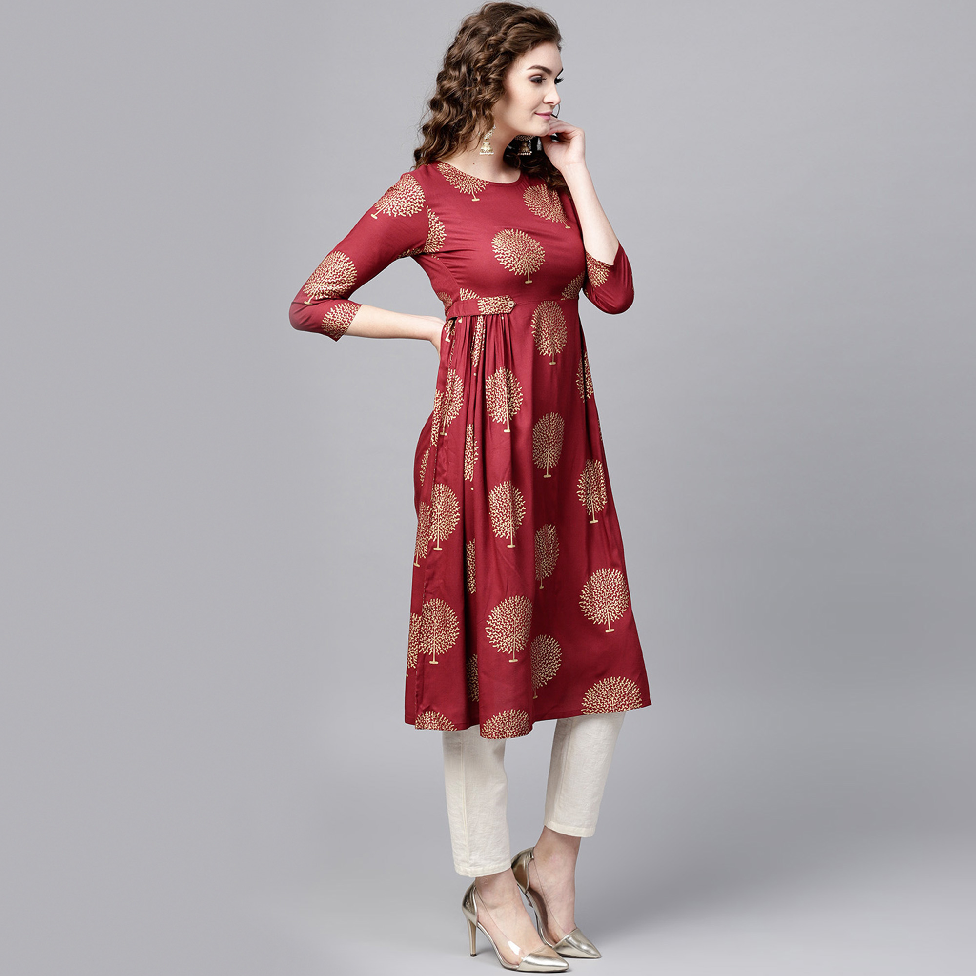 Adorning Maroon Colored Casual Printed Rayon Kurti