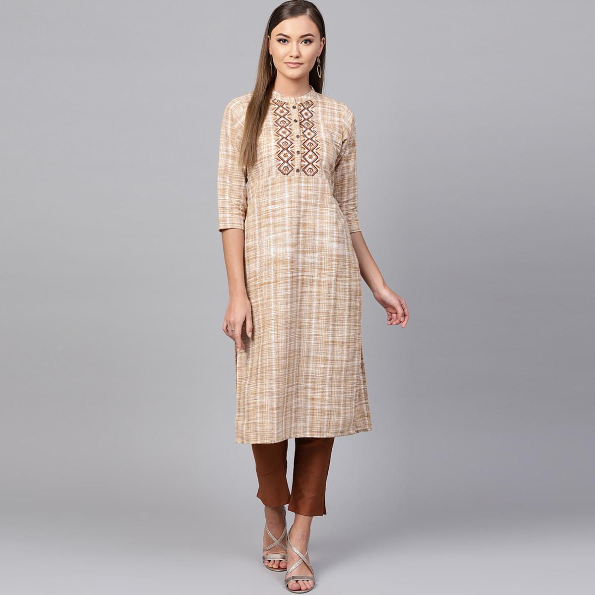 Graceful Beige Colored Casual Embroidered Cotton Kurti