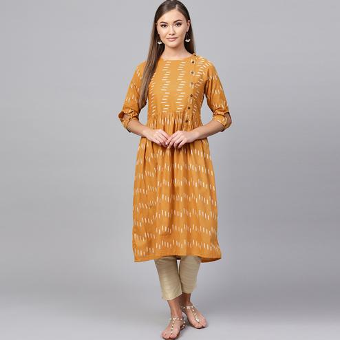 Captivating Orange Colored Casual Printed Cotton Kurti