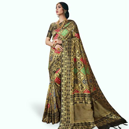 Gleaming Golden Colored Festive Wear Woven Banarasi Silk Saree
