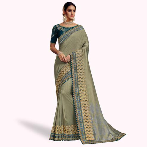 Elegant Gray Colored Partywear Embroidered Satin Georgette Saree