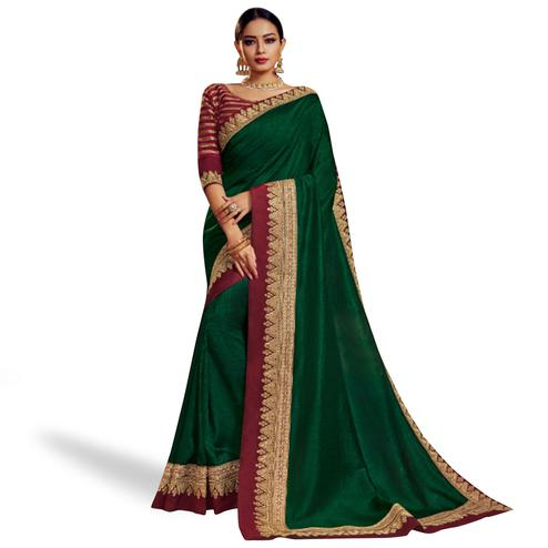 Opulent Dark Green Colored Partywear Embroidered Satin Georgette Saree