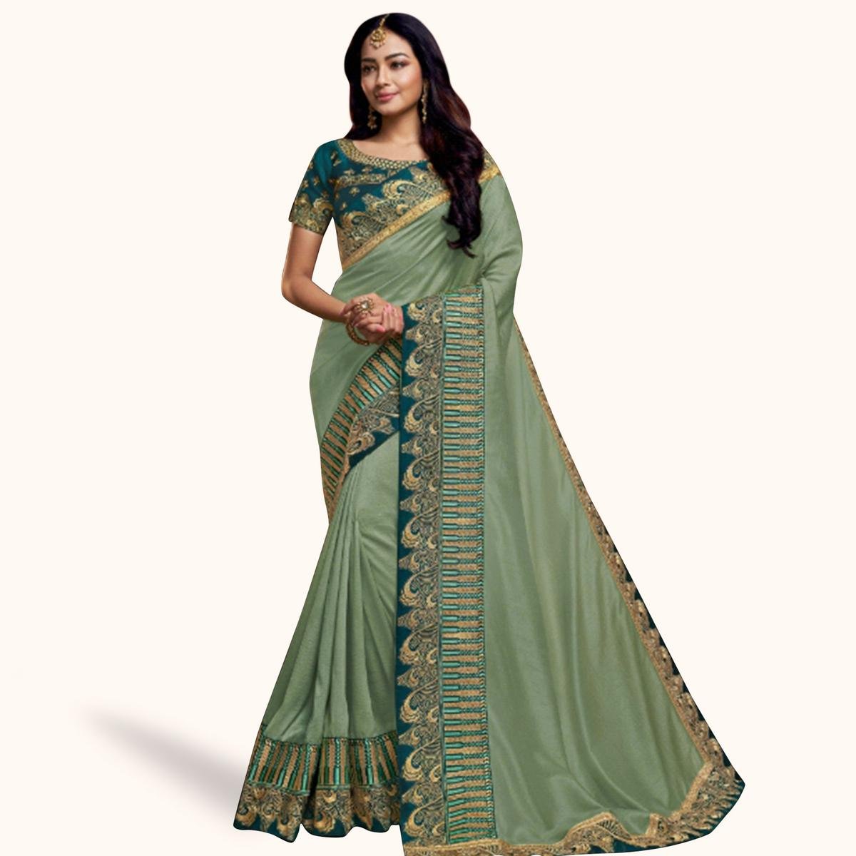Exceptional Pastel Green Colored Partywear Embroidered Satin Georgette Saree