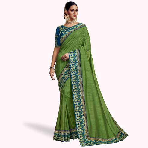 Unique Green Colored Partywear Embroidered Satin Georgette Saree