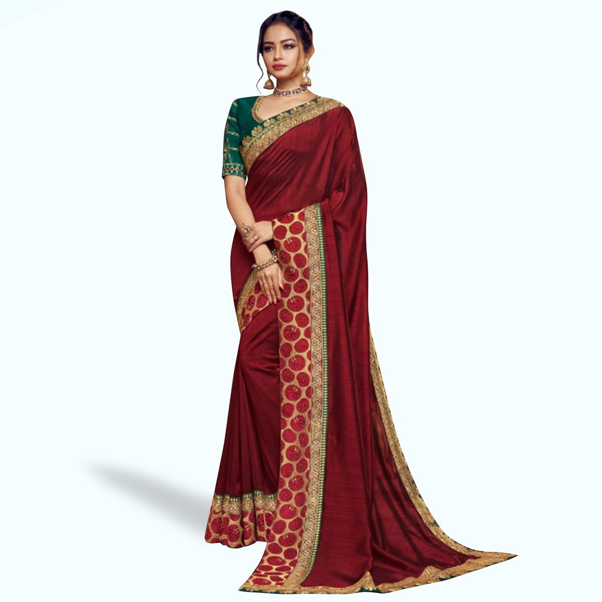 Hypnotic Maroon Colored Partywear Embroidered Satin Georgette Saree