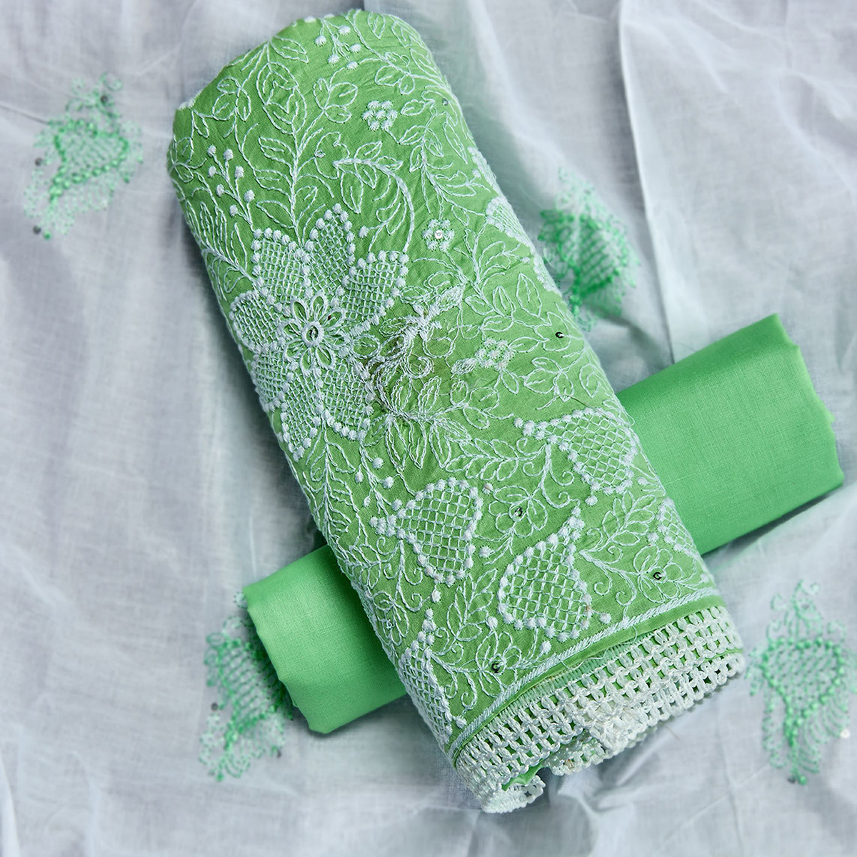 Engrossing Green Colored Partywear Embroidered Cotton Dress Material