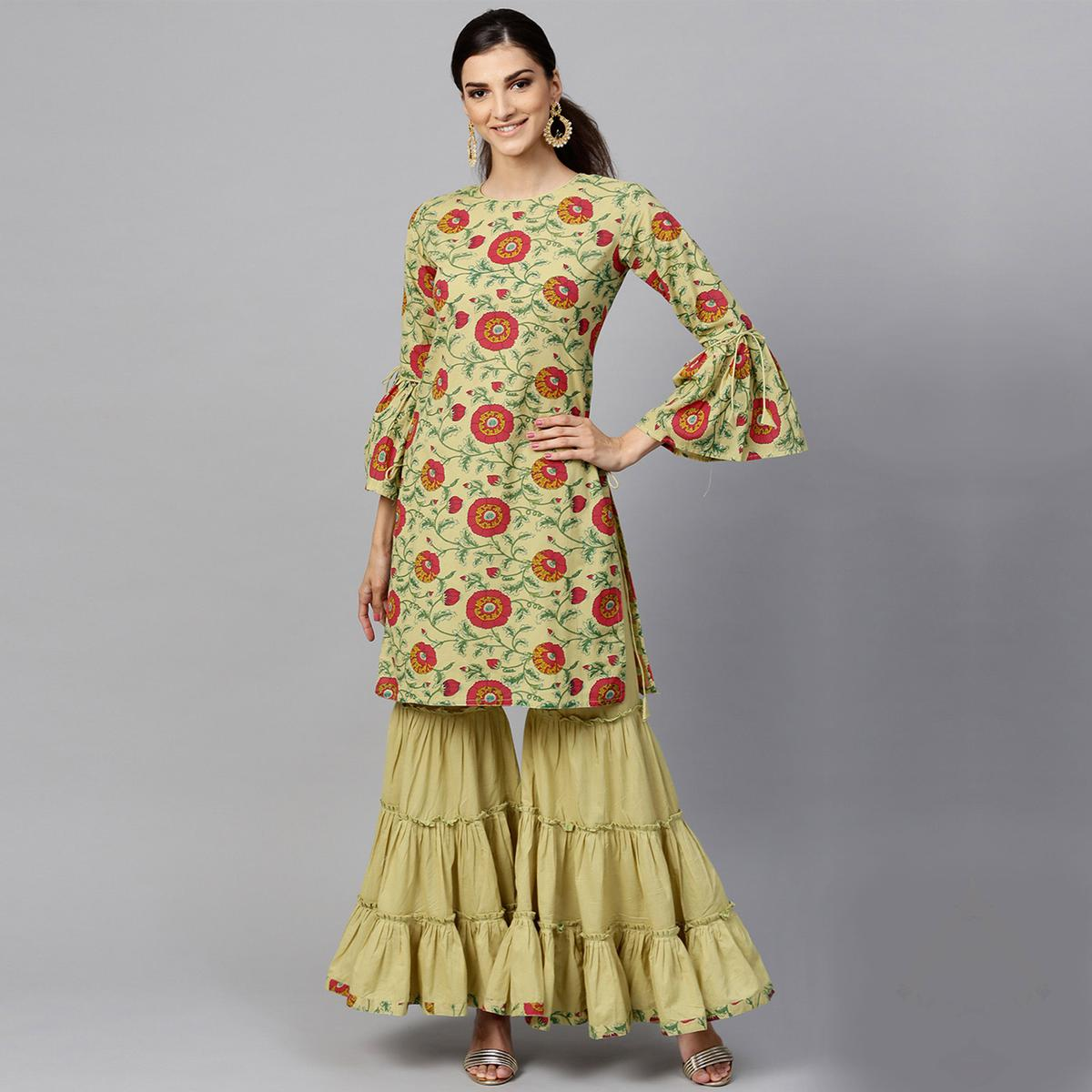 Classy Pastel Green Colored Partywear Printed Cotton Kurti And Bottom Set