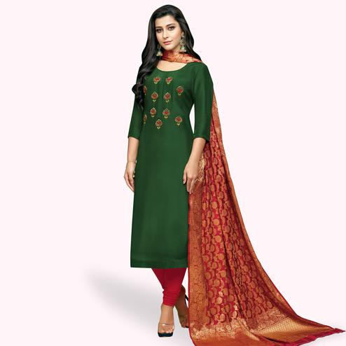 Elegant Green Colored Partywear Embroidered Silk Suit With Banarasi Dupatta
