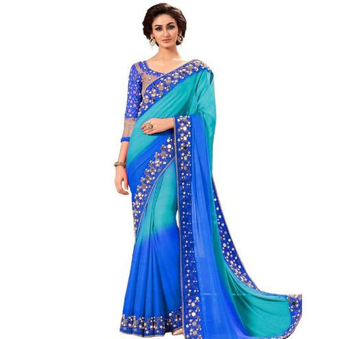 Fantastic Blue Colored Partywear Mirror Work Georgette Saree