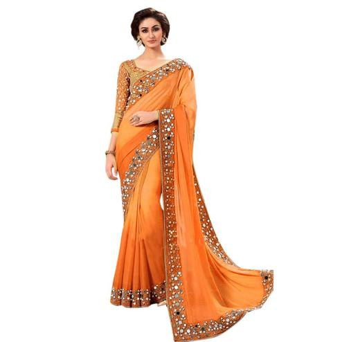 Gorgeous Orange Colored Partywear Mirror Work Georgette Saree