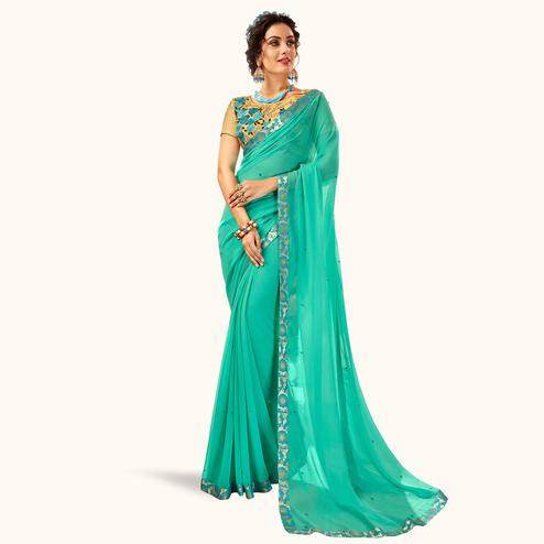 Flirty Light Sea Green Colored Partywear Georgette Saree