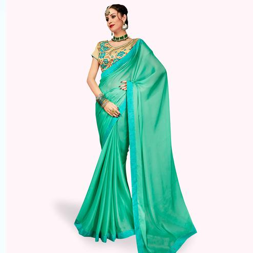 Classy Sea Green Colored Partywear Georgette Saree
