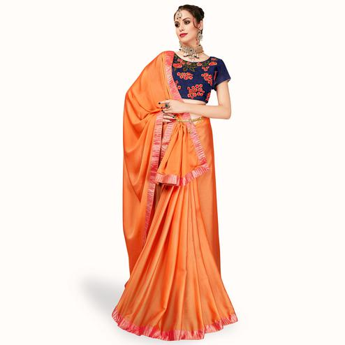 Radiant Orange Colored Partywear Georgette Saree