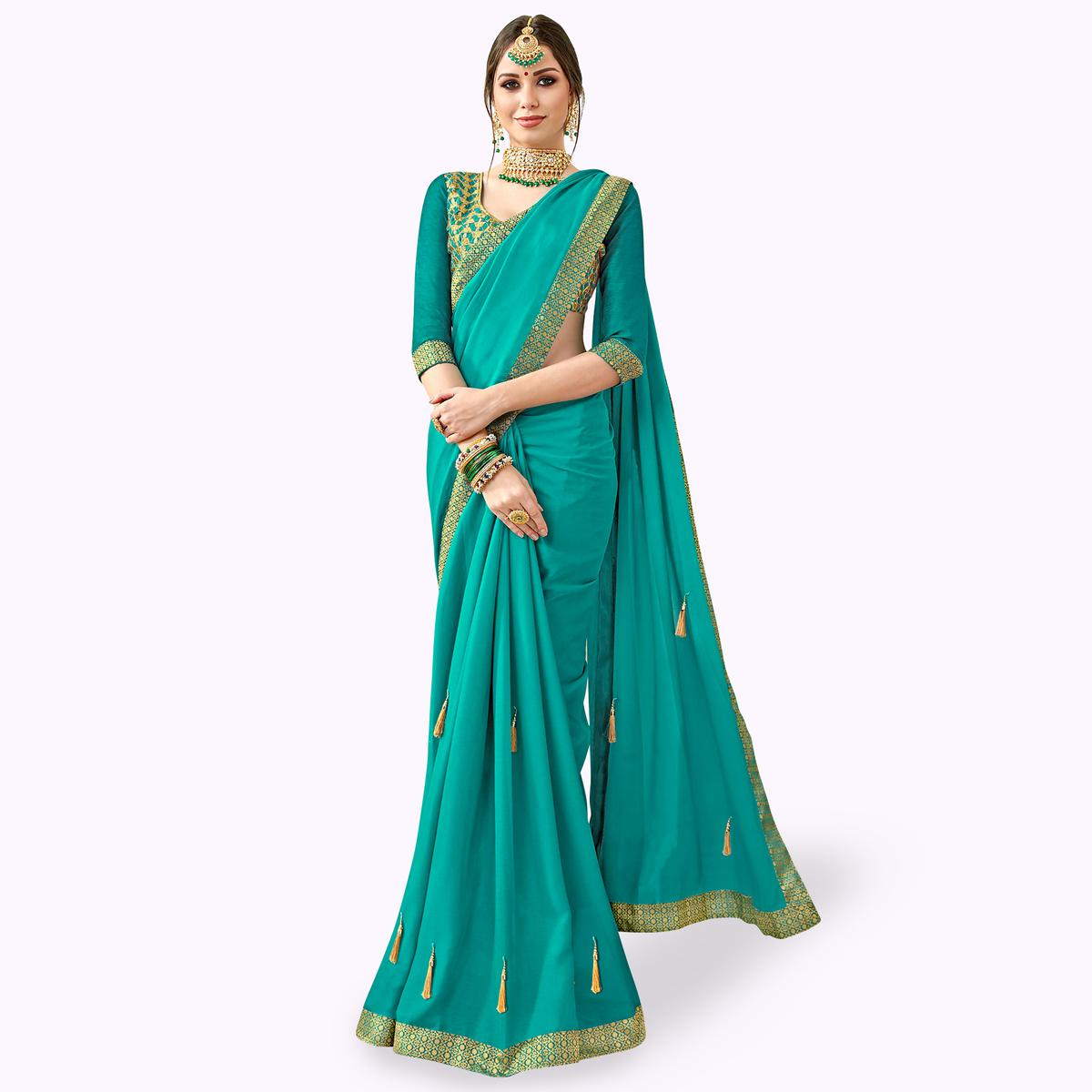 Glorious Teal Blue Colored Partywear Georgette Saree
