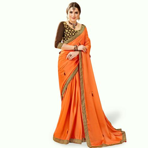 Attractive Orange Colored Partywear Georgette Saree