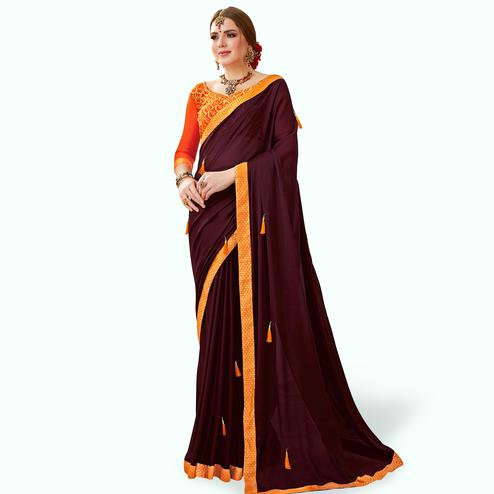 Charming Coffee Brown Colored Partywear Georgette Saree