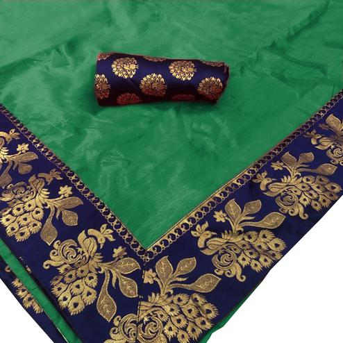 Adorning Dark Green Colored Festive Wear Woven Silk Saree