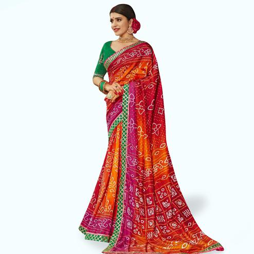 Eye-catching Red Colored Partywear Bandhani Printed Art Silk Saree