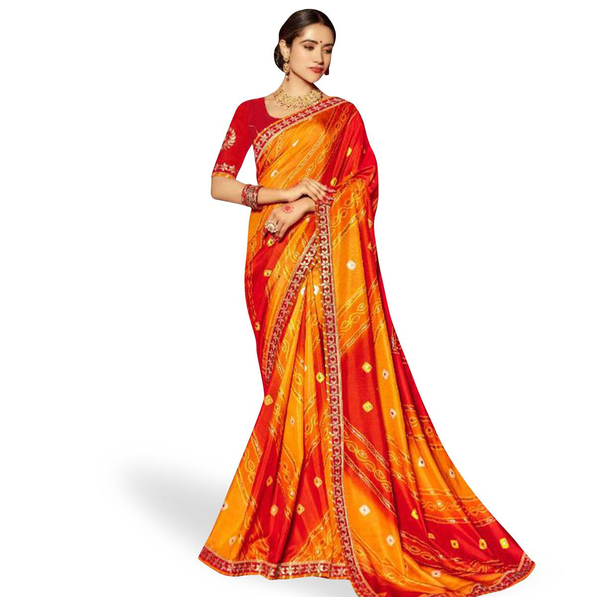 Gorgeous Orange-Red Colored Partywear Bandhani Printed Art Silk Saree