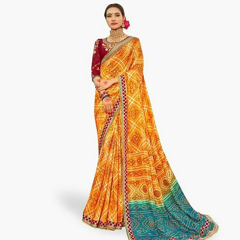 Lovely Orange Colored Partywear Bandhani Printed Art Silk Saree