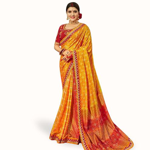 Impressive Orange Colored Partywear Bandhani Printed Art Silk Saree