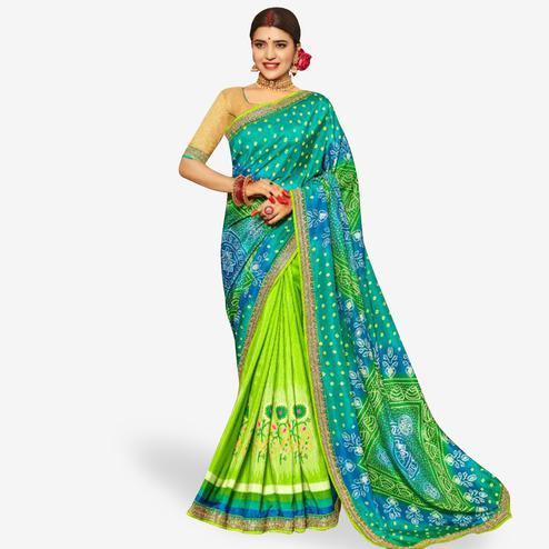 Mesmerising Green Colored Partywear Bandhani Printed Art Silk Half-Half Saree