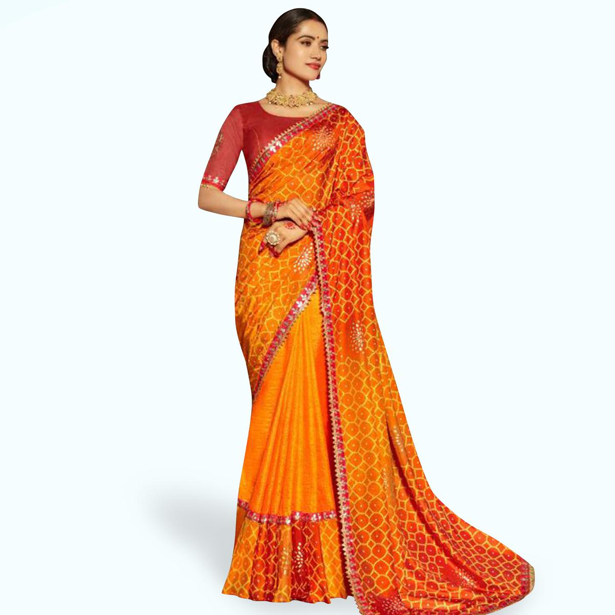 Breathtaking Orange Colored Partywear Bandhani Printed Art Silk Saree