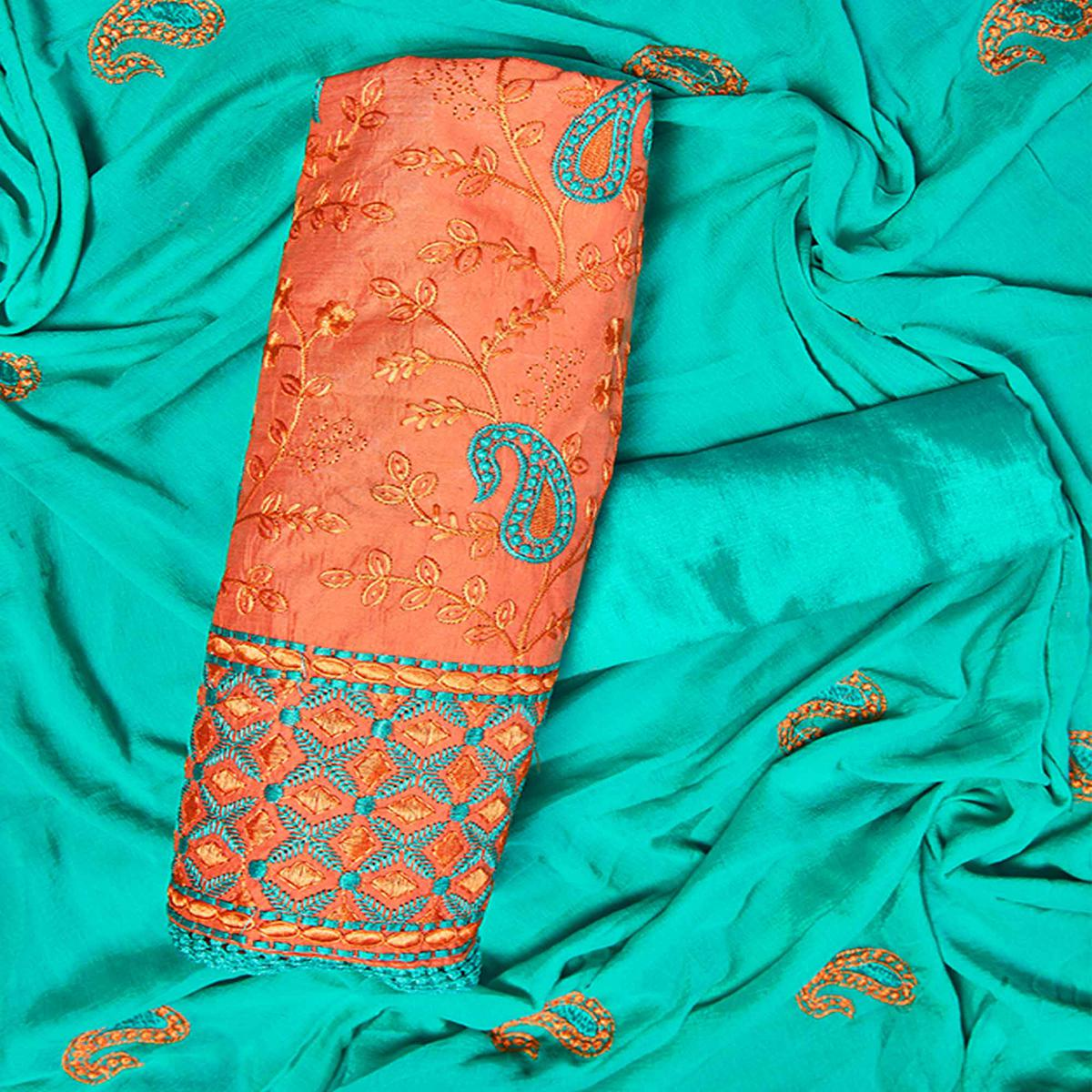 Unique Orange Colored Partywear Embroidered Chanderi Silk Dress Material